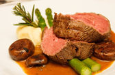 Prime Rib with Asparagus and Mushrooms — Stock Photo