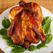 Roast Chicken on Plate Garnished with Spinach Leaves — Stock Photo #21625615