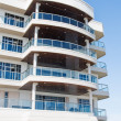 Tropical Condo Building with Balconies - Stock Photo