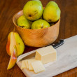 Royalty-Free Stock Photo: Bowl of Pears with Sliced Cheese and One Cut Pear