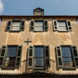 Old Plaster Building with Black Shutters and Balconies — ストック写真 #22269205