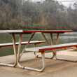 Stock Photo: Metal Picnic Table in Riverside Park