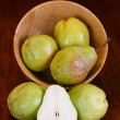 Pears in Bowl and on Table with one Halved — Stock Photo