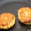 Two Crab Cakes Browning in Saute Pan — Stock Photo #22504685
