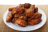 Chicken Wings on Bamboo Mat — Stock Photo