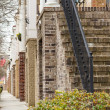 Bricks and Steps on American Townhouses - Stock Photo