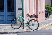 Old Green Bike Chained to Pole — Stock Photo