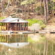 Stock Photo: Boathouse on Calm Lake