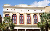 Red Arched Windows on Tropical Stucco Building — Stock Photo