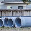 Concrete and Plastic Pipe on Site - Stock Photo