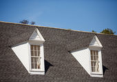 Two White Dormers on Grey Shingle Roof — Stock Photo