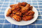 Mesquite Wings on Blue Placemat — Stock Photo