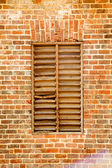 Old Wood Slat Window in Brick Wall — Stock Photo