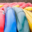 Stock Photo: Blue Green Yellow and Red Canoes