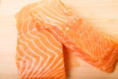 Two Atlantic Salmon Fillets on a Wood Cutting Board — Stock Photo