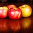 Stock Photo: Four Apples on Wood Table