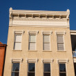 Stock Photo: Brown Stone Building with Window Trim