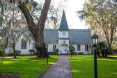 Small Church Past Brick Walk and Green Lawn Horizontal — Stock Photo