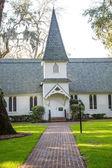 Small Church Past Brick Walk and Green Lawn Vertical — Stock Photo