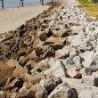 Wood Pier Beyond Rock Seawall — Stock Photo