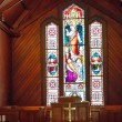 Stock Photo: Stained Glass Window Past Pulpit