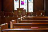 Church Pews with Stained Glass Beyond Pulpit — Stock Photo