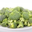 Broccoli Florets on a White Plate — Stock Photo #27792969