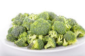 Broccoli Florets on a White Plate — Stock Photo