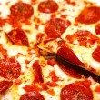 Pepperoni Pizza with Slice Lifted — Stock Photo