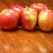 Five Apples on Wood Table with Space in Front — Stock Photo