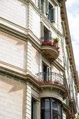 Red Geraniiums on Iron Balcony — Stock Photo
