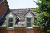 Two Dormers on Brick Homes with Wood Shingles — Stock Photo