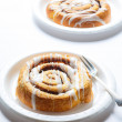 Two Cinnamon Rolls on White Plates — Stock Photo