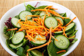 White Bowl of Salad with Cucumbers and Carrots — Stock Photo