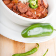 Stock Photo: Jalapeno and Cayenne Peppers with Bowl of Red Beans