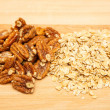 Stock Photo: Pecans and Oats on Wood Board