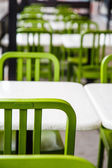 White Tables and Green Chairs — Stock Photo