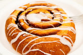 Icing on Cinnamon Roll — Stock Photo