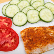 Broiled Salmon with Sliced Tomatoes and Cucumbers — Stock Photo
