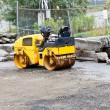 Stock Photo: Yellow Paving Roller in Old Lot