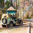Old Army car by Barricade — Stock Photo