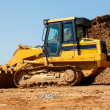 Yellow Earth Mover by Pile of Dirt — Stock Photo #32036879