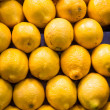 Stack of Lemons at a Fruit Market — Stock Photo
