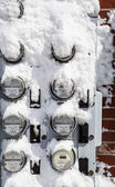 Snow on Electric Meters — Stock Photo