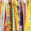 Many Colorful Table Cloths at a French Market — Stock Photo