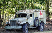 Old Medic Truck by Bamboo and Security Fence — Stock Photo