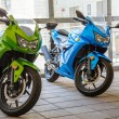 Stock Photo: Green and Blue Sport Cycles