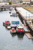 Red Tugboats at Pier — Stockfoto