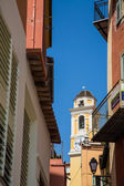 Yellow Clock Tower Under Blue Sky Past Alley — Stok fotoğraf