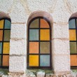 Stock Photo: Colored Arched Windows in Plaster Building